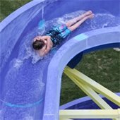 Person going down water slide