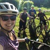 Selfie of four bicycle riders
