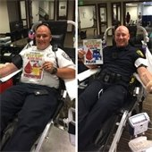 Firefighter and police officer donating blood